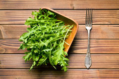 Arugula leaves in bowl Royalty Free Stock Photos