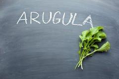 Arugula leaves on chalkboard Stock Image