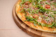Arugula Pizza Detail. Traditional Pizza With Arugula and Tomato Italian Cuisine stock photos