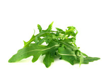 Arugula, rucola fresh heap leafs  on white Stock Images