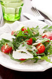 Arugula salad. With cheese and pine nut Stock Image