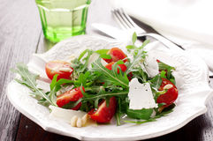 Arugula salad. With cheese and pine nut Royalty Free Stock Photography