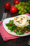 Arugula salad with baked goat's cheese Royalty Free Stock Image