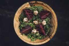 Arugula salad with beetroot and mozzarella. In rustic  wooden bowl Stock Photos