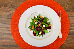 Arugula Salad, Boiled Beets, Cheese and Walnuts Royalty Free Stock Images
