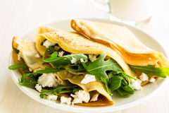 Arugula salad and cheese crepes Royalty Free Stock Photo