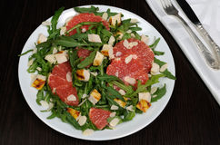 Arugula salad with chicken, grapefruit and almonds. Salad with grilled chicken and arugula, grapefruit, almonds royalty free stock photography