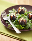 Arugula Salad and Figs Stuffed with Goats Cheese Stock Photo