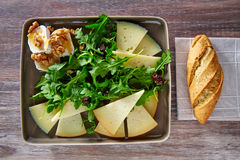 Arugula salad with goat cheese honey and nuts Royalty Free Stock Images