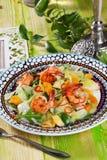 Arugula salad, mandarin oranges, shrimp still life on the boards of Italian Royalty Free Stock Photo