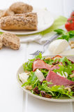 Arugula salad with meat and mozzarella Royalty Free Stock Images