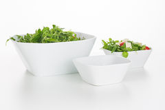 Arugula salad in square bowls isolated Royalty Free Stock Photos