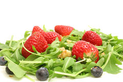 Arugula salad w/berries & nuts Royalty Free Stock Image