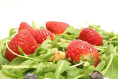 Arugula salad w/berries & nuts upclose royalty free stock images