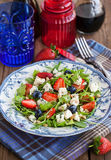 Arugula, strawberry, blueberry and blue cheese salad Stock Image
