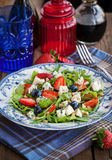Arugula, strawberry, blueberry and blue cheese salad Royalty Free Stock Photography