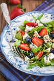Arugula, strawberry, blueberry and blue cheese salad Royalty Free Stock Photo