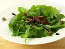 Arugula with sun dried tomatoes Stock Image