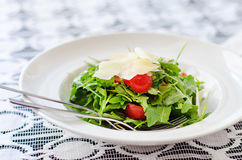 Arugula and tomatoes salad Stock Photos