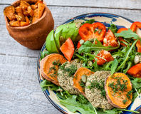 Arugula, vegan lentil fried cutlets, baked sweet potato Stock Photos