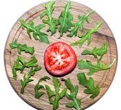 Arugula y tomate Imagen de archivo