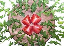 Arugula y tomate Imagen de archivo libre de regalías
