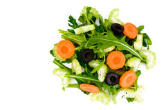 Arugula, zanahoria, aceituna y apio aislados en el fondo blanco fotos de archivo libres de regalías