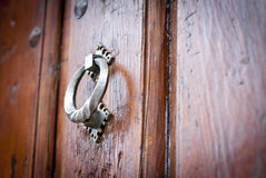 Arum knocker on the  wooden door Royalty Free Stock Photos