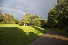 Arundal castle walkway and rainbow. Arundal Castle gardens with rainbow Stock Image