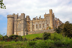 Arundel Castle. Side view of Arundel Castle, West Sussex, England standing on a grassy hill Royalty Free Stock Photography