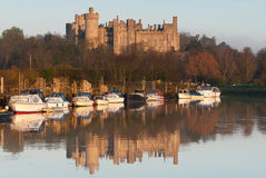 Arundel Castle. A shot of Arundel castle taken in the golden hour showing reflections of the castle and the boats in the river Arun Royalty Free Stock Photo