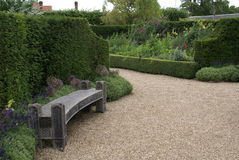 Arundel castle garden path with a timber seat in England Stock Photo