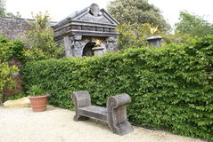 Arundel castle garden's timber bench in England Stock Image