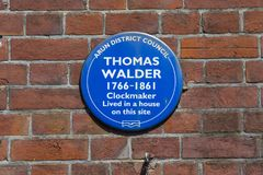 Thomas Walder Plaque in Arundel. ARUNDEL, UK - MAY 5TH 2018: A blue plaque on the High Street in Arundel, marking the location where Clockmaker Thomas Walder Royalty Free Stock Images