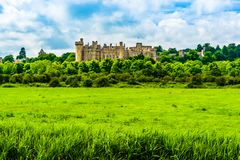 Arundel Castle in West Sussex, England, UK. Arundel, UK: Panoramic view of the Arundel Castle surrounded by a green forest, a restored and remodeled medieval stock photo