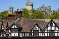 Arundel in West Sussex. The imposing sight of Arundel Castle looking over the market town of Arundel in West Sussex, UK stock photo