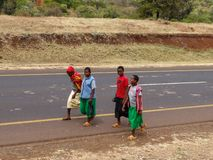 Arusha, Tanzania - August 2012. Unidentified Young local boys walking on the road stock image