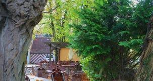 Arv för värld för Tyskland` s berömt Rothenburg, romantiska frilufts- kaféer i sagastaden på vägen lager videofilmer