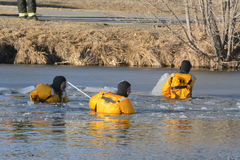 Arvada Firemen breaking ice searching for dog Royalty Free Stock Photography