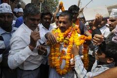 Arvind Kejriwal being garlanded. Stock Images