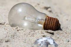 Żarówka w piasku Fotografia Stock