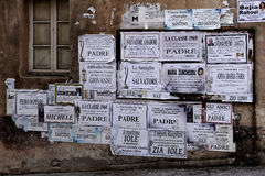 ARZACHENA, SARDINIA/ITALY - MAY 20 : Posters on a wall in Arzach. Ena on May 20, 2015 Royalty Free Stock Photos