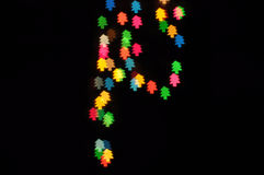 As árvores de Natal assinam dentro o fundo da noite Imagens de Stock