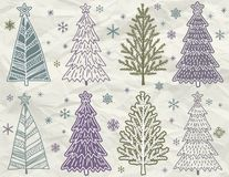 As árvores de Natal no beije amarrotam o fundo Fotografia de Stock