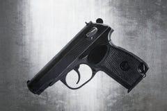 As armas de fogo atiram em um fundo e em uma textura fotos de stock royalty free