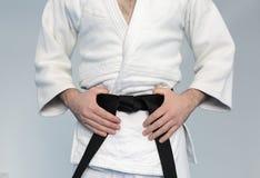 As artes marciais dominam com cinturão negro Fotografia de Stock Royalty Free
