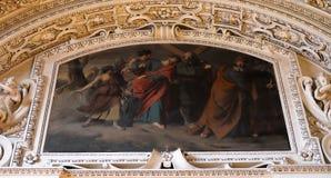 as 5as estações da cruz, Simon de Cyrene levam a cruz Fotos de Stock Royalty Free