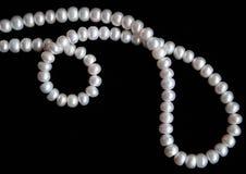 as background black pearls silk white Royaltyfri Foto