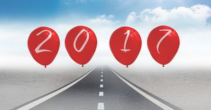 2017 as balloons against a composite image 3D of road in sky Royalty Free Stock Photography