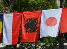 As bandeiras de Mônaco, de Albânia e de Japão foto de stock royalty free